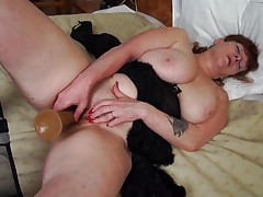 She's mature, hot and has a pair of immense boobs that need a hard cock between them. Meet Leah, a chubby mature whore that's masturbating in front of us. Leah uses her big bad dildo to fill her pussy and has a great time doing it. The cunt rubs her boobs while masturbating and moans with delight wishing for a real dick