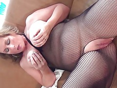 This sexy mature bitch with big round tits is sitting on the sofa wearing pantyhose and she is playing with her boobs. She begins rubbing her large shaved pussy becoming very horny. The blonde takes now a long dildo and starts riding it waiting the big orgasm coming soon.