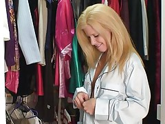 Georgie is a hot mature blonde, she is in this cloths store and searches for something nice to wear. We get to watch this hot slut and how she takes advantage of the situation and gropes her breasts to make us horny. Doesn't Georgie knows that she looks better naked and preferably with hard cock between her lips?
