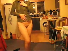 Mature housewife dancing with no panties in the kitchen at xmas.