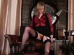 Pretty blonde mature Louise starts stripping herself and touching her wet cunt. She reveals a beautiful golden lingerie and plays with her stockings a little to turn you on. She spreads her legs and shows off her pussy, then moves back to her titties and tickles them a little. What will she do next?