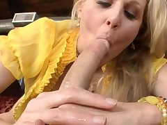 Breasty older playgirl is engulfing on dude's pecker hungrily