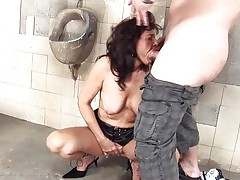 She's a dirty whore and does everything a man asks her. Here she is, in an abandoned public toilet sucking this guy and then licking his anus before he fucks her from behind. She's a cougar that enjoys a good dirty fuck and probably will enjoy his semen too so stick with us and watch this bitch in full action